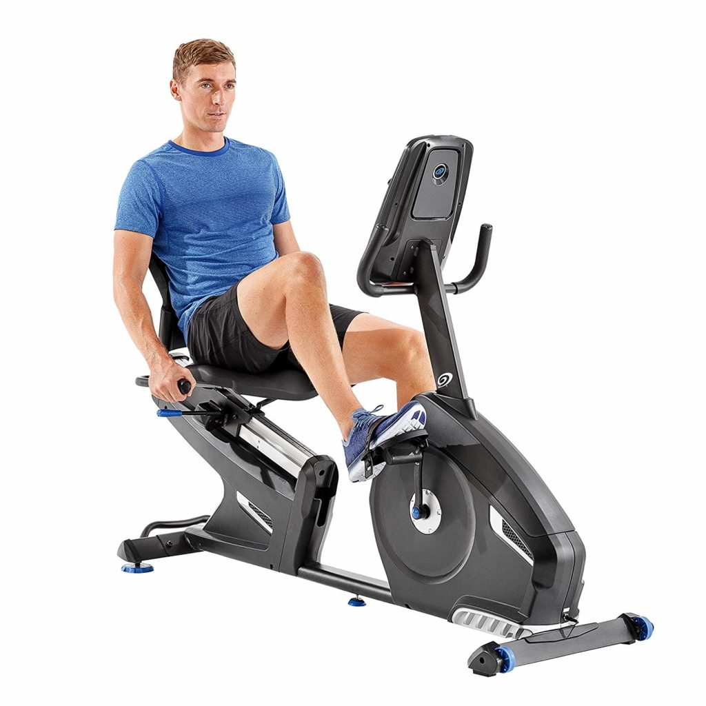 A man using nautilus 616 recumbent bike