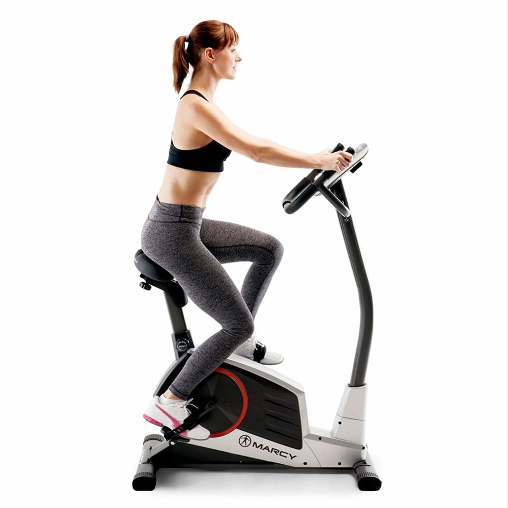 Woman using the upright bike Marcy ME-702