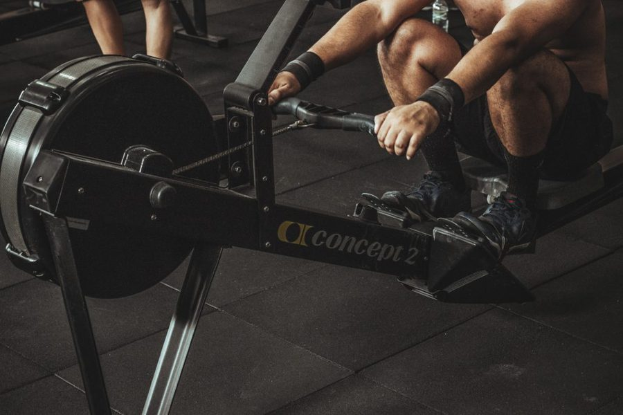 A man using a rowing machine on a gym
