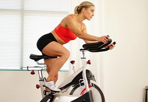 A woman using a spin bike
