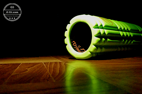 A foam roller on a wooden floor