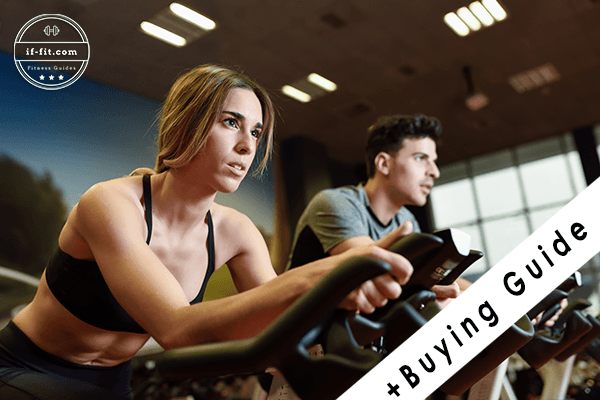 A woman and a man using a spinning indoor bike