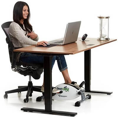 A woman using deskcycle2 on her desk